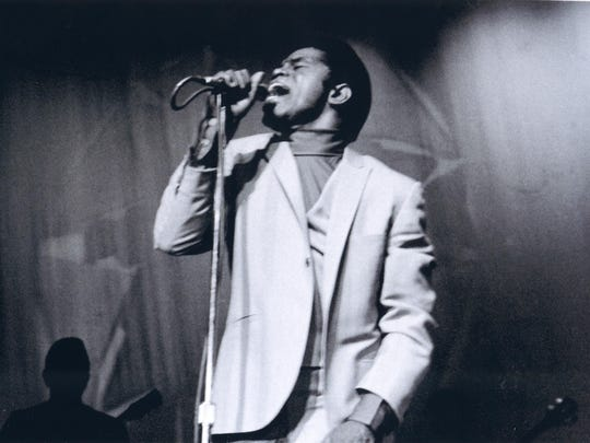 """James Brown, performing at the Apollo in New York City in the 1960s, in an image from """"Mr. Dynamite: The Rise of James Brown."""""""
