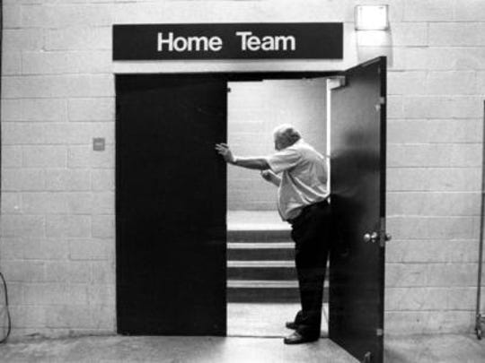 A photo of coach Don Haskins at the locker room door