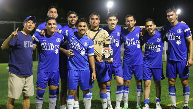 Guam Shipyard poses with the champions trophy of the 2016 Budweiser Futsal League after defeating defending champions Rovers FC 4-3 in the league's championship match at the Guam Football Association National Training Center futsal courts Sunday evening. In the photo from left to right are GFA Executive Committee Member George Lai, Mark Chargualaf, Christopher Reyes (behind Chargualaf), Ajay Pothen, Jestin Escobar, Jason Landstrom (holding trophy), Min Sung Choi, Donald Weakley, Andre Gadia and Micah Paulino.