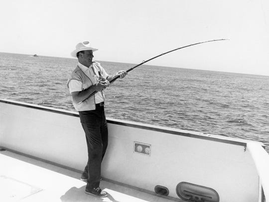 John Wayne fishing off a friend's boat, The Searcher,