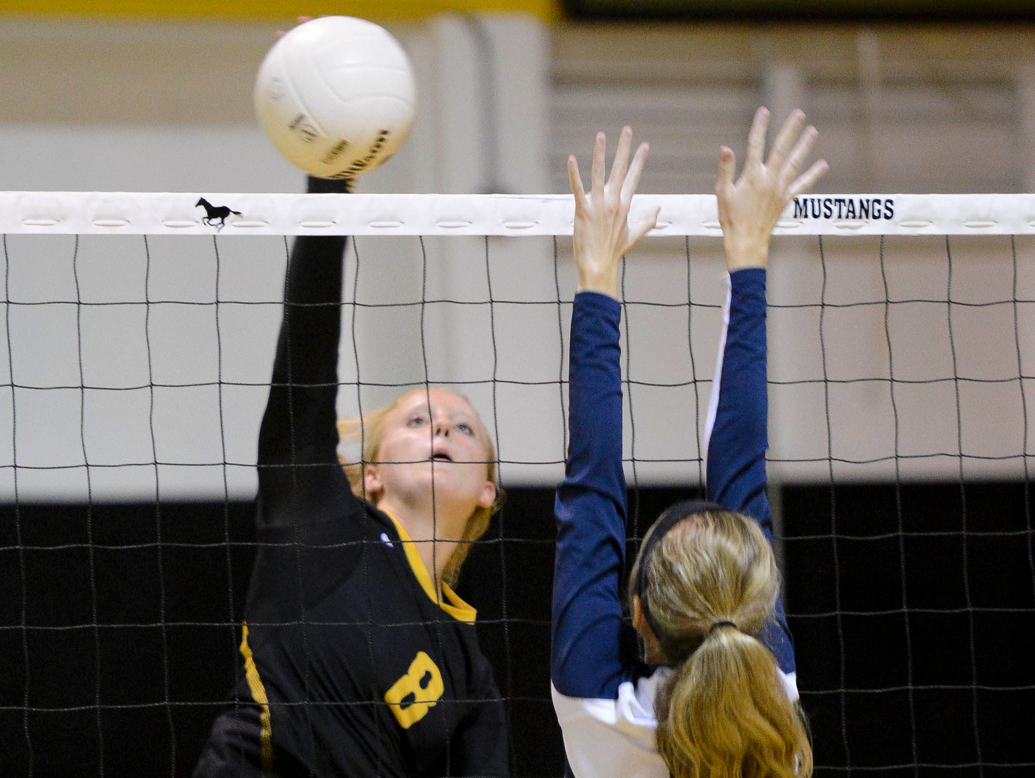 Alyssa Zwolensky of Merritt Island spikes the ball during Tuesday's match against Cocoa Beach. Zwolensky had nine kills in the match.