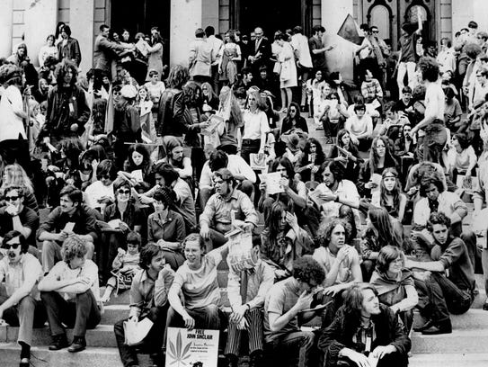 Members of the White Panther Party and others on the steps of the Capitol in Lansing in 1971.