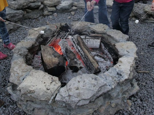Warm up to a campfire at Barfield Crescent Park.