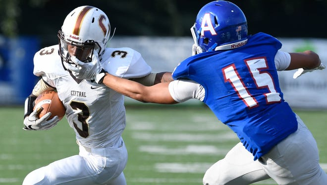 Central's Tre'Jon Evans (3) turns the corner on Apollo's Sam Parm (15) as Evansville Central plays Owensboro Apollo in the first game of a double header at the Independence Bank Border Bowl played at Steele Stadium in Owensboro, August 25, 2017.