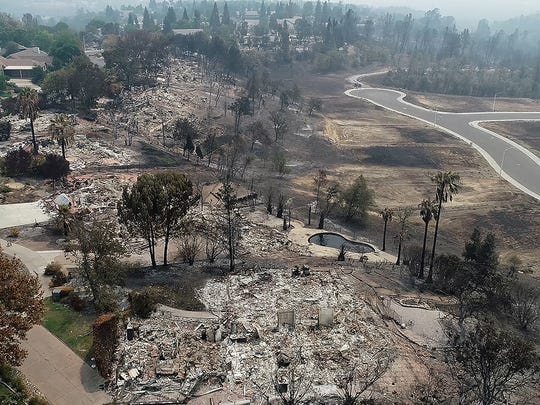 A large line of homes in the River Ridge Park subdivision along White Water Circle show the damage from the Carr Fire Wednesday August 1, 2018 in Redding, CA.