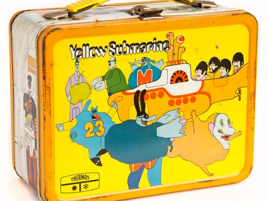 "A ""Yellow Submarine"" lunch box is shown."