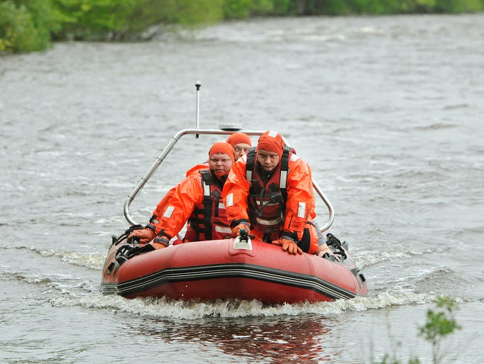 Sauk Rapids rescue workers return to shore with a man who reportedly jumped into the Mississippi River from the Sauk Rapids Bridge Thursday.