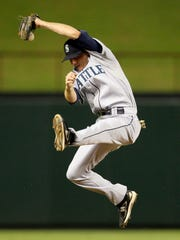 Seattle Mariners shortstop Josh Wilson knocks down