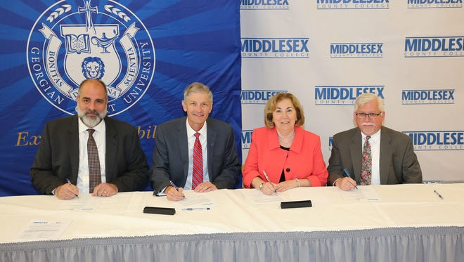 From left to right: Dr. William J. Behre, provost, and Dr. Joseph R. Marbach, president, Georgian Court University; and Dr. Joann La Perla-Morales, president, and Dr. Mark McCormick, vice president for academic and student affairs, Middlesex County College.