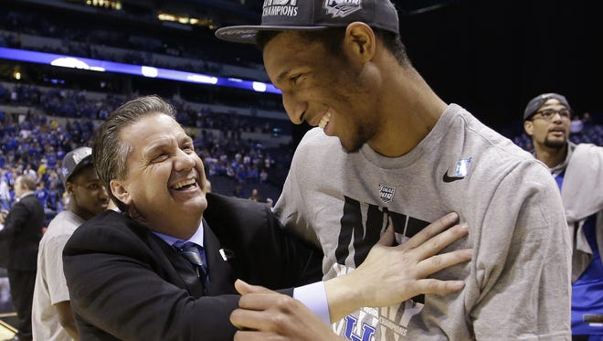 Coach John Calipari and Marcus Lee celebrates Kentucky's NCAA basketball tournament win on March 30, 2014.