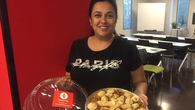 Kay Diggs poses with sweet treats at a Tappetite-catered CO+HOOTS event.