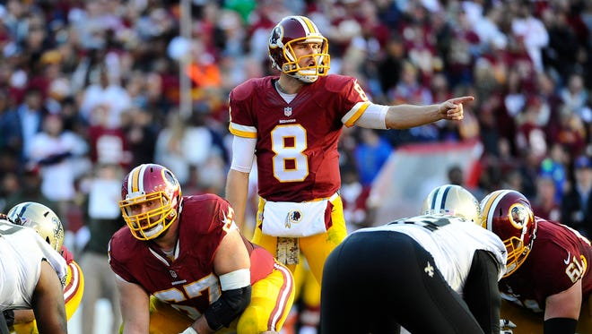 Washington Redskins quarterback Kirk Cousins looks over the line of scrimmage against the New Orleans Saints.