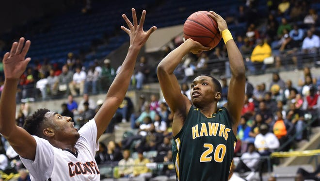 Shaw's Elijah Jackson (20) shoots against Leake County during MHSAA 1A Girls quarterfinal action held Friday March 6th, 2017 at the Mississippi Coliseum in Jackson, MS.