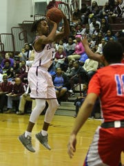 Pensacola's Shawndarius Cowart (5) makes a jump shot against Pine Forest at Pensacola High School on Friday, January 19, 2018.