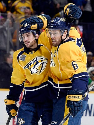 Predators defenseman Shea Weber (6) celebrates with Calle Jarnkrok, left, after Weber scored a goal against the Stars in the second period Tuesday at Bridgestone Arena.