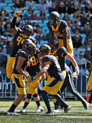 California players celebrate scoring a touchdown during their win over Hawaii.
