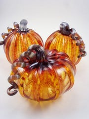 """Handblown glass """"Harvest Pumpkins"""" by Luke Adams, part of the """"Gifts From the Heart"""" art show from Sept. 24 to Oct. 30 at Edgewood Orchard Galleries."""