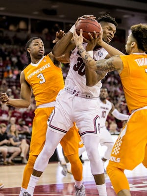 Feb 25, 2017; Columbia, SC, USA; South Carolina Gamecocks forward Chris Silva (30) grabs a rebound from Tennessee Volunteers guard Robert Hubbs III (3) and Tennessee Volunteers guard Lamonte Turner (1) in the first half at Colonial Life Arena. Mandatory Credit: Jeff Blake-USA TODAY Sports