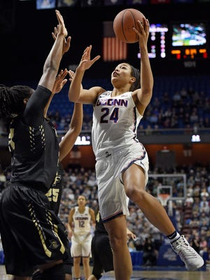 Connecticut's Napheesa Collier shoots over Central Florida's Joslyn Massey, left, during the first half of an NCAA college basketball game on March 5, 2017.