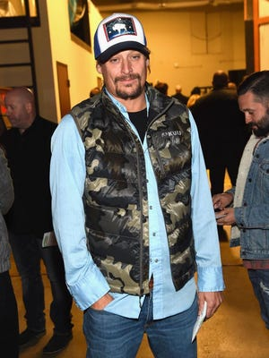 Kid Rock attends the Eagles concert at the Grand Ole Opry House on October 29, 2017 in Nashville. News outlets report the 20-foot-tall (6-meter-tall) neon sign to be mounted over Rock's recently opened bar will feature a giant guitar in which the base of the instrument is intentionally shaped like a woman's buttocks.