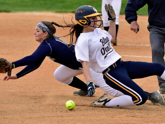 Chambersburg's Tara Harmon, left,  stretches but can't