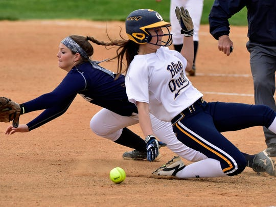 Chambersburg's Tara Harmon, left,  stretches but can't get the throw as Ally Brown of Greencastle reaches 3rd base during their game Monday. May 9, 2016. Greencastle got the 6-5 victory.