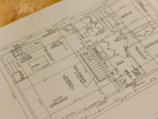 A blueprint for the house under construction by students