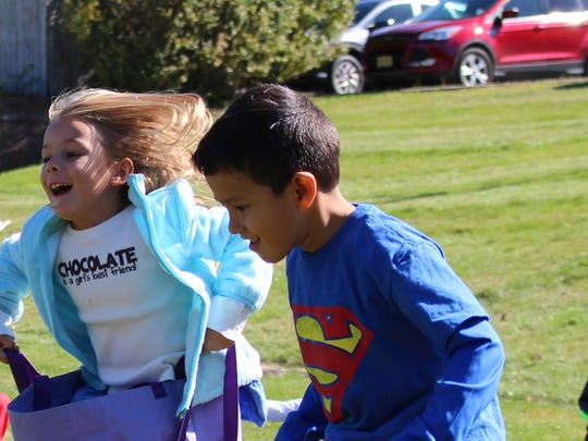 """Central kindergartners Isabella Lofling and Luis Penaloza have fun with """"Don't be a cCouch Potato"""" sack races at Field Day on Oct. 14"""