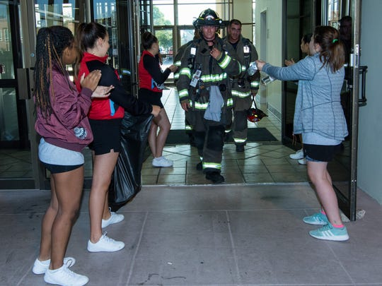 Las Cruces firefighters, including trainee Tyler Aguirre, receive applause and offers of refreshments after completing their climb during the Las Cruces Memorial Stair Climb event on Sunday, Sept. 10, 2017. The fundraising event, held as a memorial to 9/11, took place at the Wells Fargo Tower.