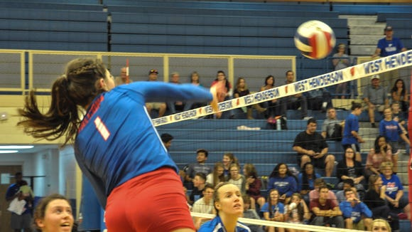 Mary Catherine Ball (1) and West Henderson are home for Tuesday's 3-A Western Regional championship match.