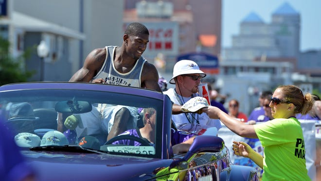 Then Baltimore Raven Chykie Brown signs autographs during the annual Ravens Roost Parade in Ocean City in 2013.