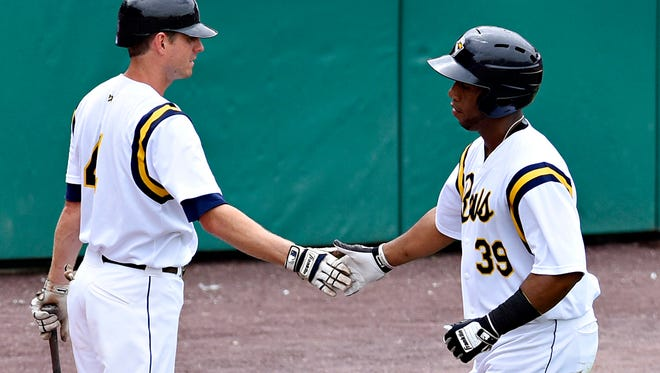 York Revolution's Alfredo Marte, right, finishes celebrating a homerun during Sunday's game against the Lancaster Barnstormers. York lost the game, 3-1. Dawn J. Sagert photo