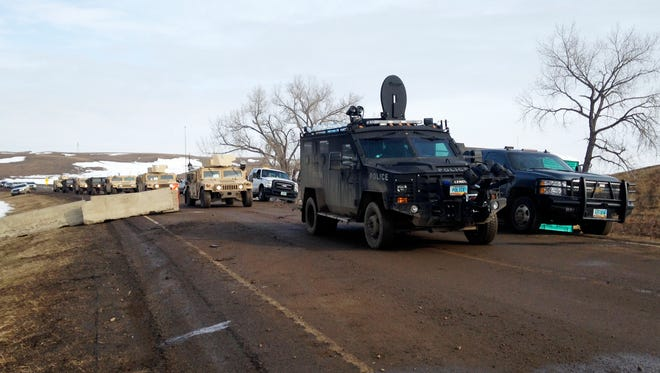 Law enforcement vehicles arrive at the Dakota Access pipeline protest camp near Cannon Ball, N.D., on Feb. 23, 2017.