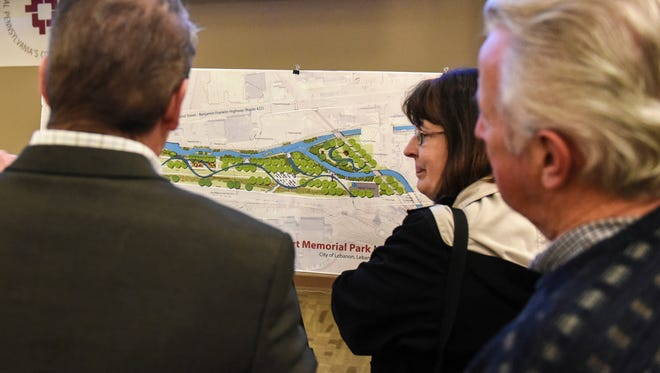 People look over the mast plan for a proposed park as the Lebanon Valley Conservancy and Friends of the Lebanon Valley Rail Trail hosted a meeting at HACC's Lebanon campus on Thursday, March 30, 2017. The meeting was held to gather public input for a proposed park -- Wengert Memorial Park -- in the 1600 block of Chestnut Street.