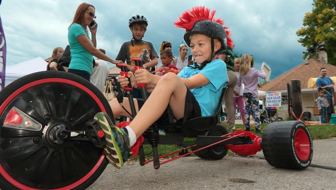 Jaxon Luedtke takes on his brother in the Big Wheel Races at the Thiensville-Mequon Lions Club's Applefest in 2015. This year's event will be held Sunday, Oct. 1.