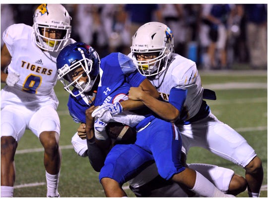 Cougar running back Ke'Shawn Brown is tackled by Frenship High School's Brandyn Moreno during Friday's game at Shotwell Stadium Sept. 22, 2017. Cooper won, 62-3.