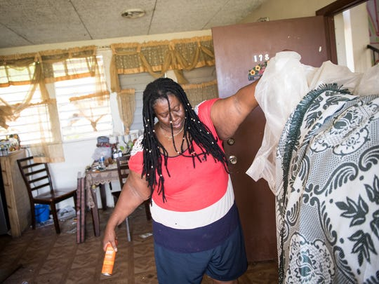 During Hurricane Irma, Gwendolyn Rollins sheltered in a small bathroom of her apartment in the Tutu High Rise, a public housing complex destroyed by Hurricane Irma. She moved to a shelter after the storm.