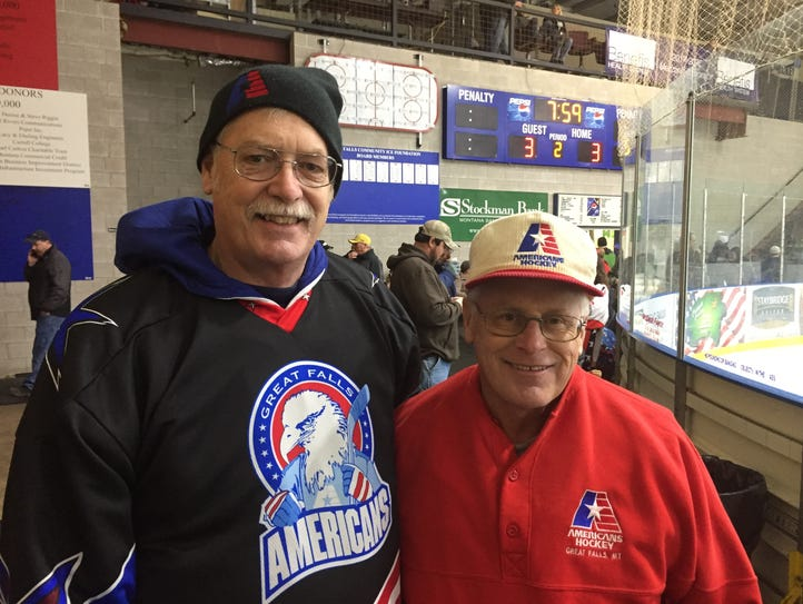 Hockey fans Gary Geiger (left) and Jeff Cunniff were