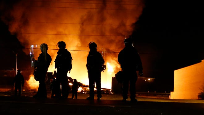 Protesters burn several business Monday night during the disturbance in Ferguson, Mo.