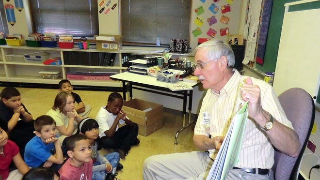 Dean Baldwin reads to children at Edison Elementary School in Erie.