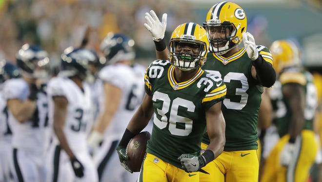 Green Bay Packers' LaDarius Gunter (36) celebrates his fumble recovery with teammate Reggie Gilbert (93) in the first half Thursday, August 10, 2017, at Lambeau Field in Green Bay, Wis.  Dan Powers/USA TODAY NETWORK-Wisconsin