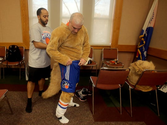 Dan Bova gets into costume as Hudson, the mascot for the Westchester Knicks, before a game at the Westchester County Center in White Plains March 24, 2017. Bova was invited by the team to see what it's like to be a team mascot. Dan Bova gets into costume as Hudson, the mascot for the Westchester Knicks, before a game at the Westchester County Center in White Plains March 24, 2017. Bova was invited by the team to see what it's like to be a team mascot. Helping Bova into his costume was Dan Brown, one of Hudson's backstage helpers.