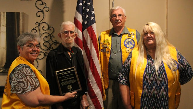 Chuck Galush (center) was honored Wednesday evening with a plaque of appreciation by Lion Club member, Ruth Wilkes (left), Presdient Bob Hein, (center right) and Brenda Dunn (right) for his outstanding work with New Mexico Lions Operation KidSight.