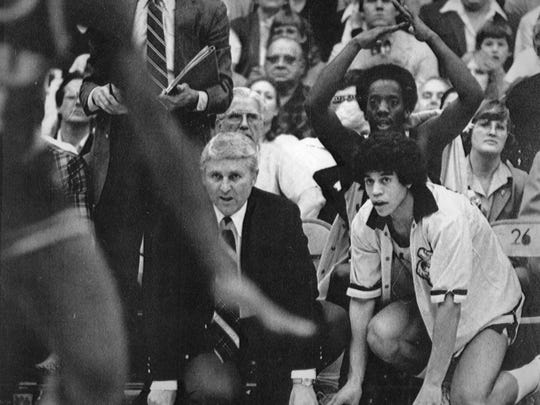 Iowa coach Lute Olson and freshman guard Steve Carfino react during the closing seconds of a win over Indiana on Feb. 20, 1981. Kenny Arnold calls for a timeout in the background.