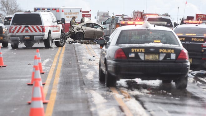 New Mexico State Police respond to an accident on U.S. Highway 550 south of Bloomfield on Wednesday. Icy roads contributed to multiple accidents along the highway, causing injuries and one fatality.