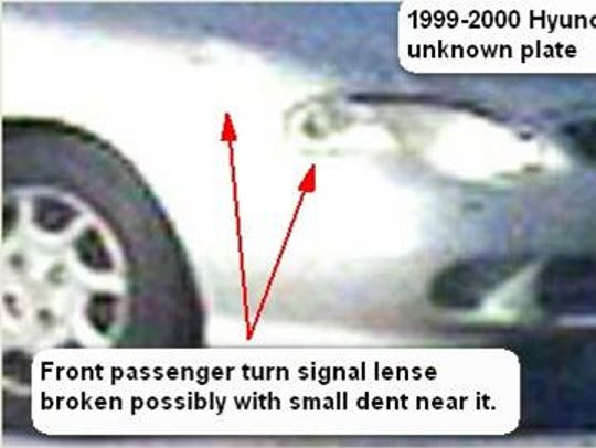 Closeup of damage of suspect's car.