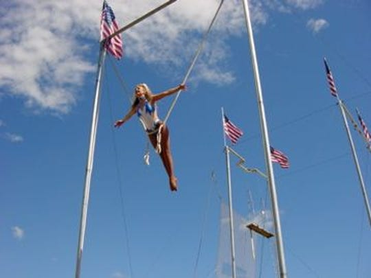Alecia Hansen performs her aerial act 30 feet above the ground.
