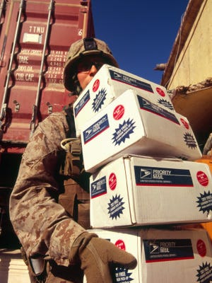 An effort to make care packages for U.S. military members around the world is expected to return to its roots in a Michigan living room.