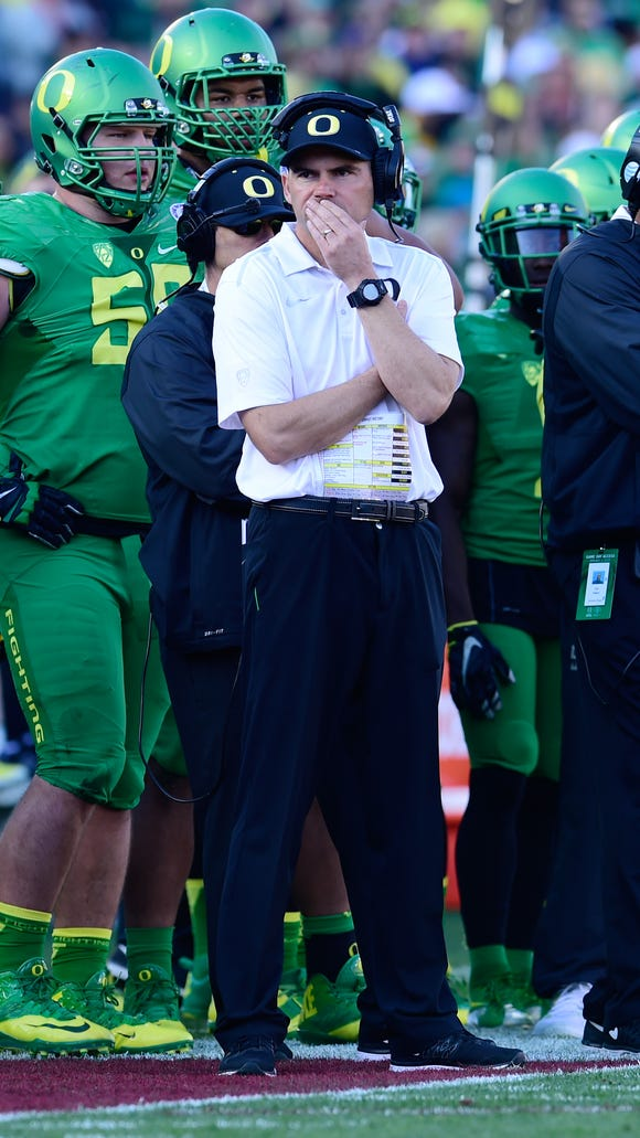 Jan 1, 2015; Pasadena, CA, USA; Oregon Ducks head coach Mark Helfrich looks on from the sidelines during the first half of the 2015 Rose Bowl college football game against the Florida State Seminoles at Rose Bowl. Mandatory Credit: Robert Hanashiro-USA TODAY Sports