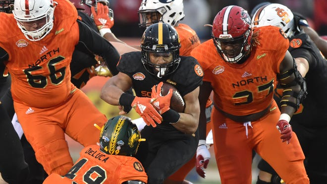 South squad running back Ito Smith of Southern Miss (25) runs the ball against the North squad Saturday during the second half of the 2018 Senior Bowl at Ladd-Peebles Stadium in Mobile, Alabama.